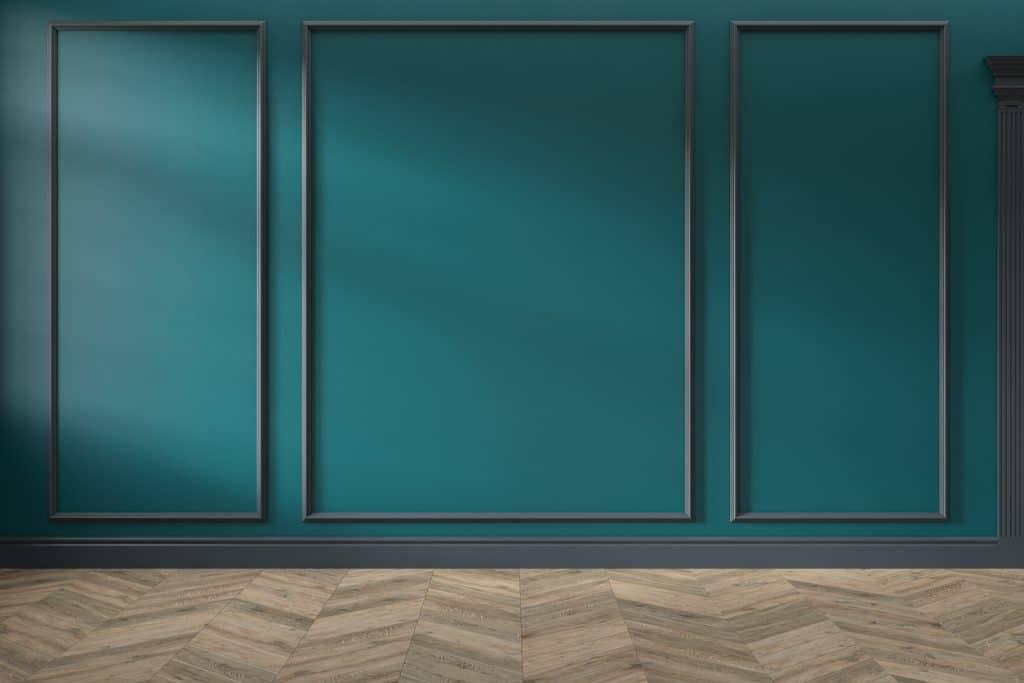 Oceanside-colored walls with paneling and herringbone hardwood