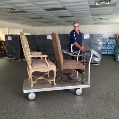 Primrose Center CEO, Bill McCormac, helping to move in the furniture