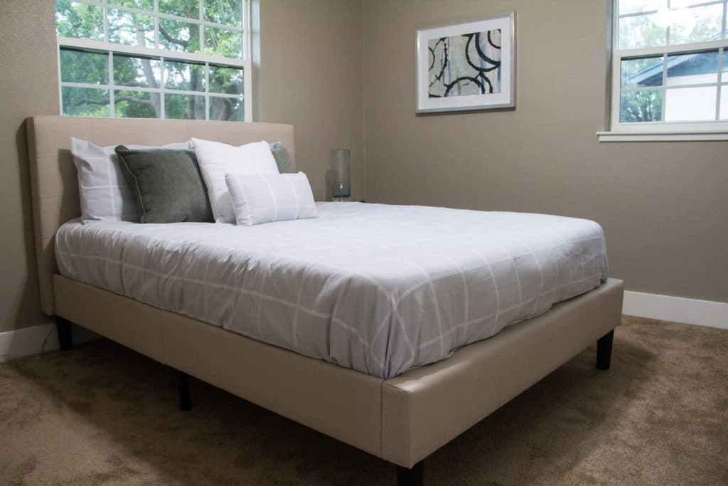 Sophisticated guest bedroom of the King Zombie from Zombie House Flipping S2 E3