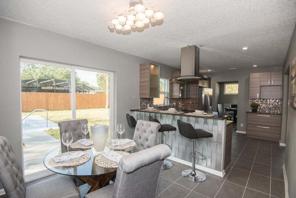 Dining and kitchen view of 4100 Kasper Drive, the tv dinner home from Zombie House Flipping