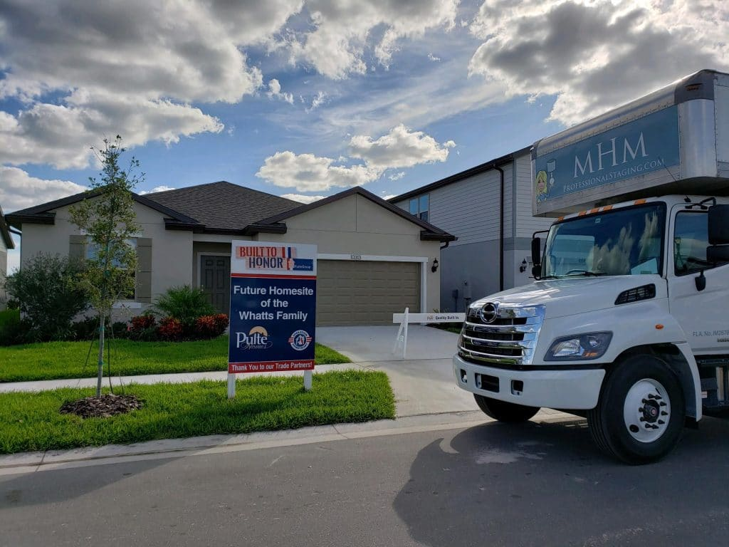 MHM Professional Staging truck in front of the new Whatts family home