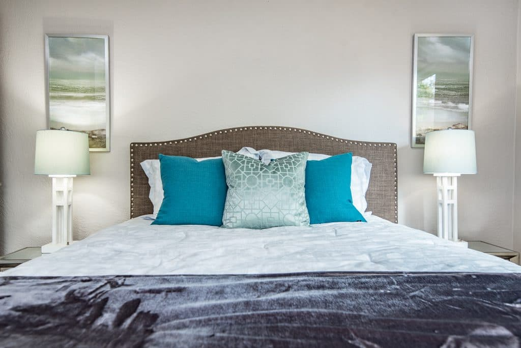Close-up of the bed in the master bedroom of the house from Zombie House Flipping season two episode six