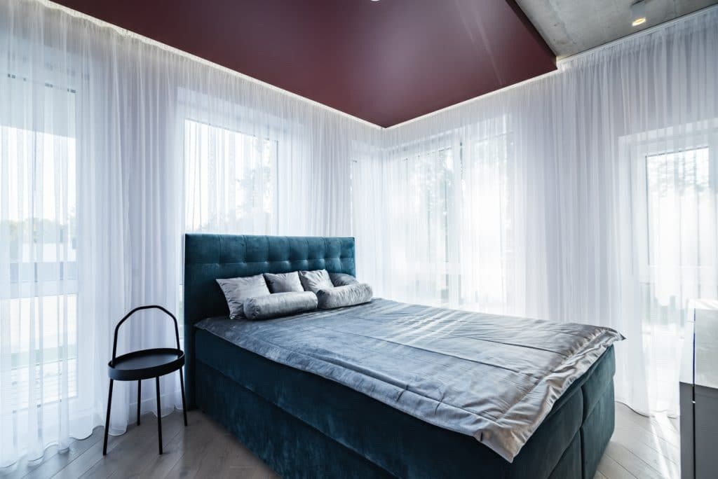 Bedroom with mature grape painted on the ceiling