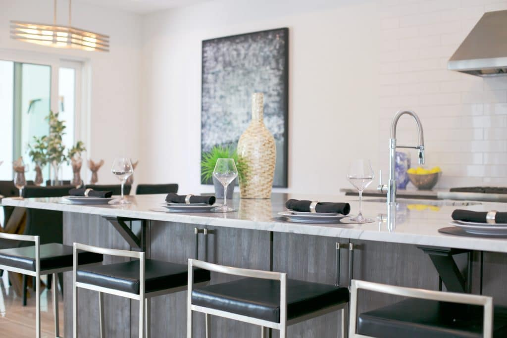 An example of professional home staging: breakfast bar with black leather stools