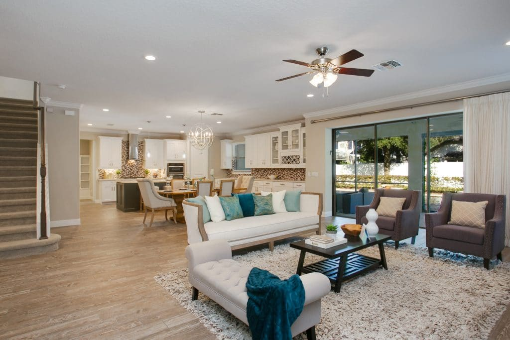 An example of professional home staging: white couch with blue throw pillows in a living room