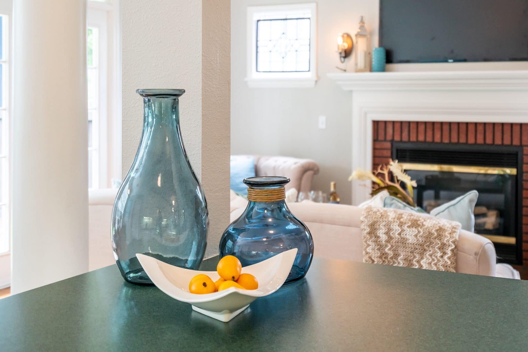 An example of soft staging: two vases and a bowl on a kitchen counter