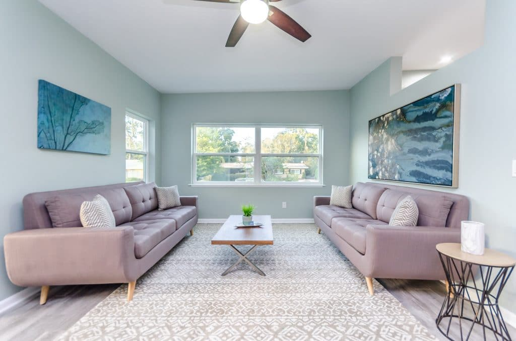 Formal seating area of the house featured in Zombie House Flipping season two episode eight, staged by MHM Professional Staging