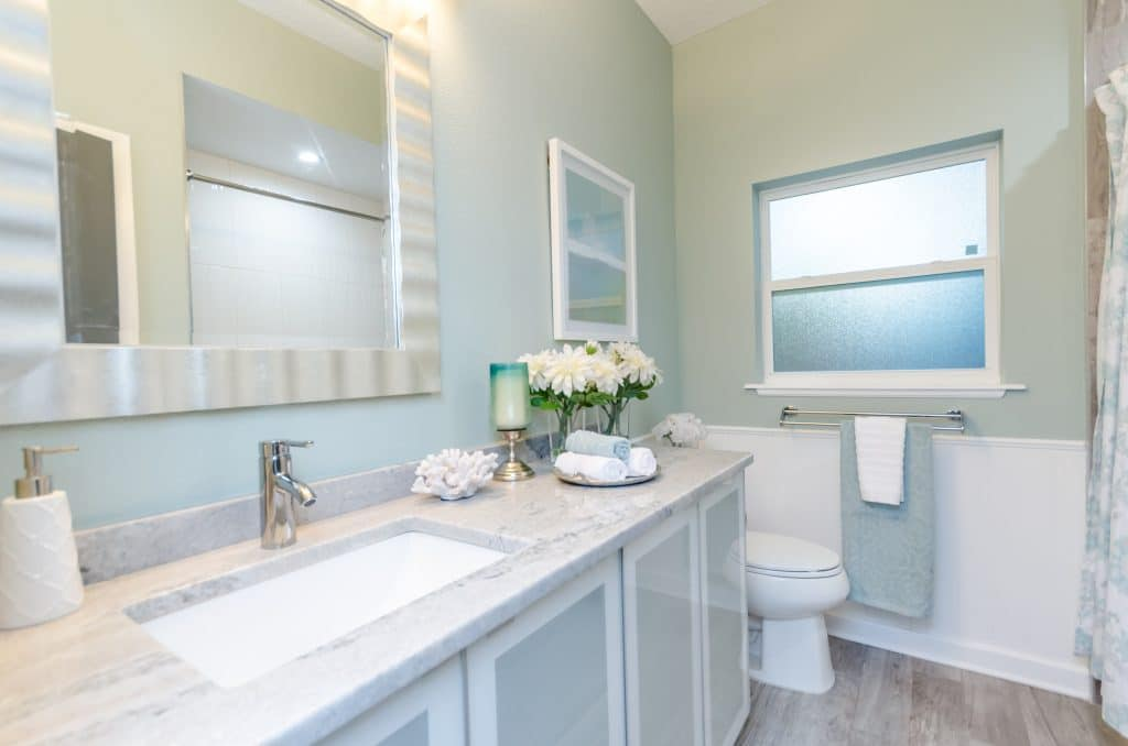 Guest bathroom of the house featured in Zombie House Flipping season two episode eight, staged by MHM Professional Staging