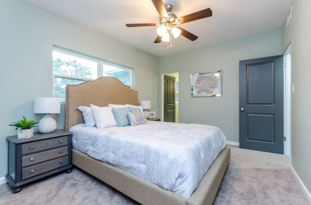 Master bedroom of the house featured in Zombie House Flipping season two episode eight, staged by MHM Professional Staging