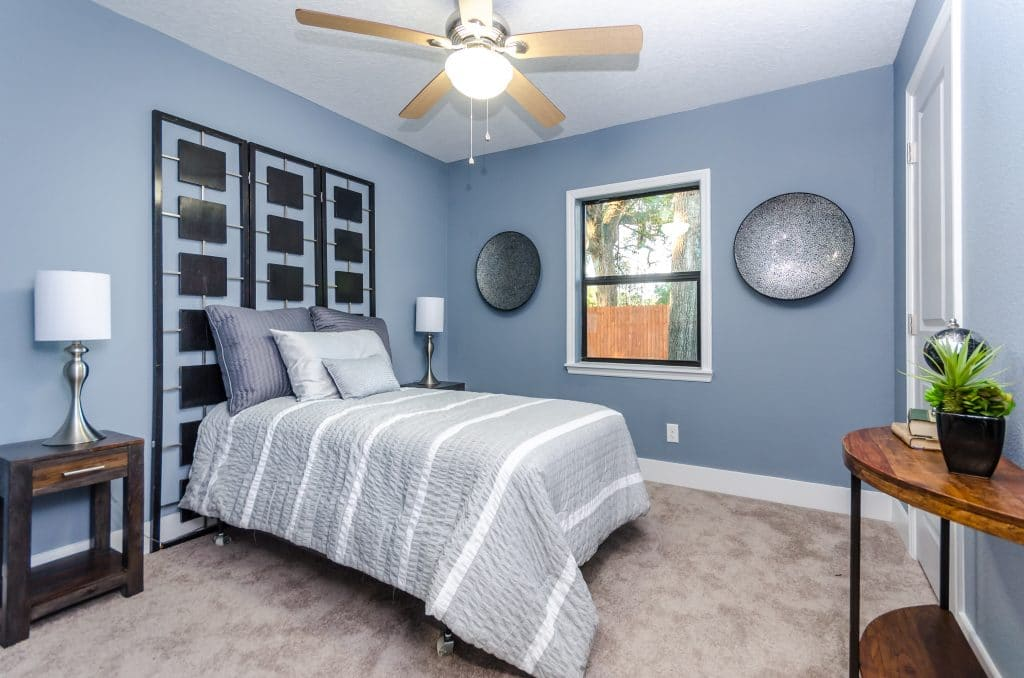 Guest bedroom of the Wadeview Park home on Zombie House Flipping season two episode nine