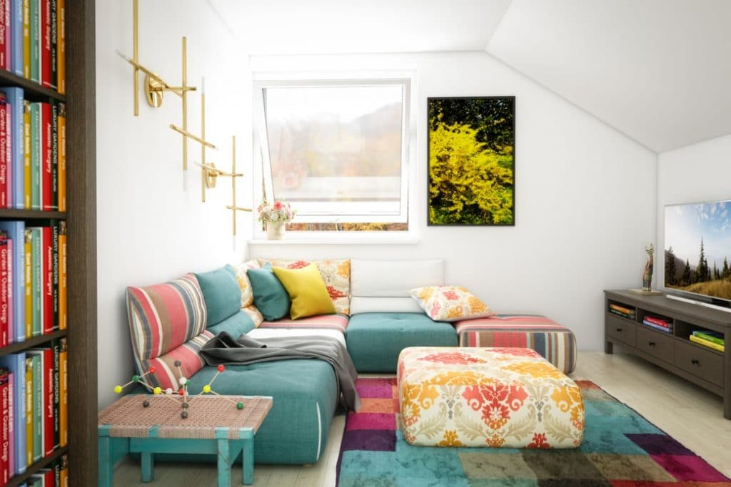 Couch in the color Green Bay with yellow and pink accent pillows