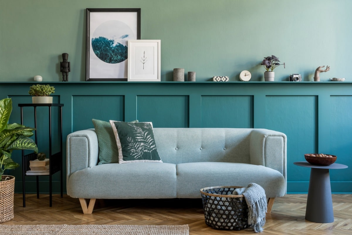 Living room with wainscotting painted with Sherwin-Williams Green Bay paint