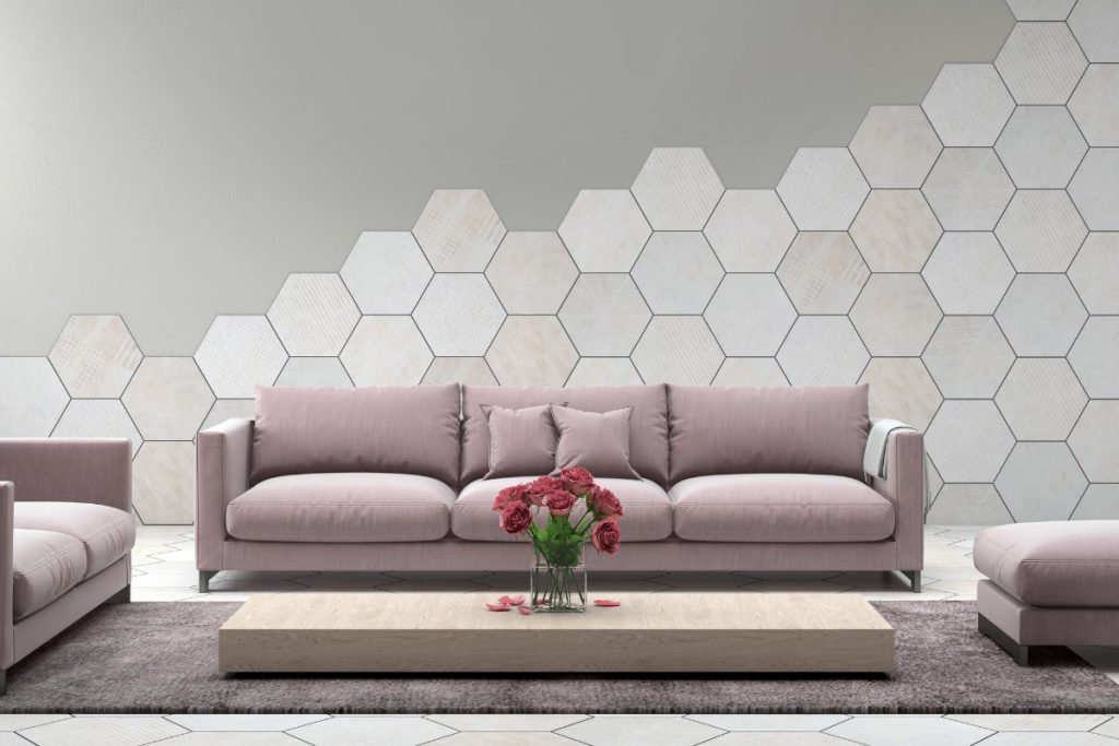 Grape Mist colored couch against gray wall with white hexagonal tiles