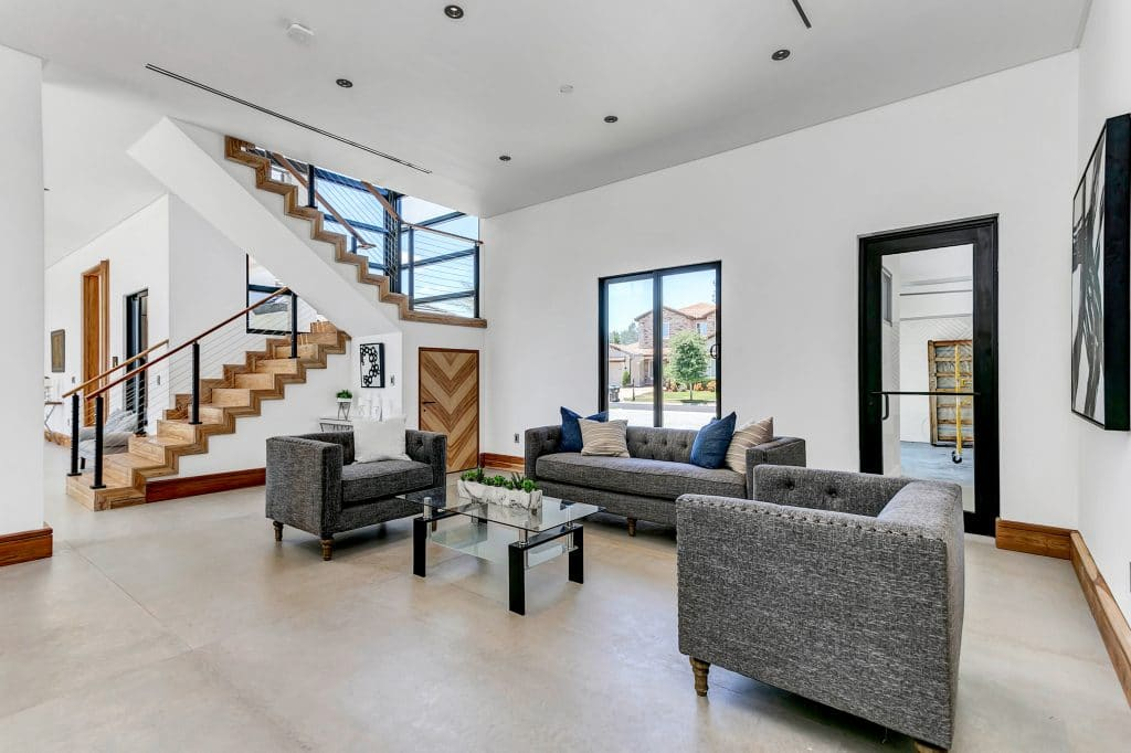 Living room in a modern home with open staircase