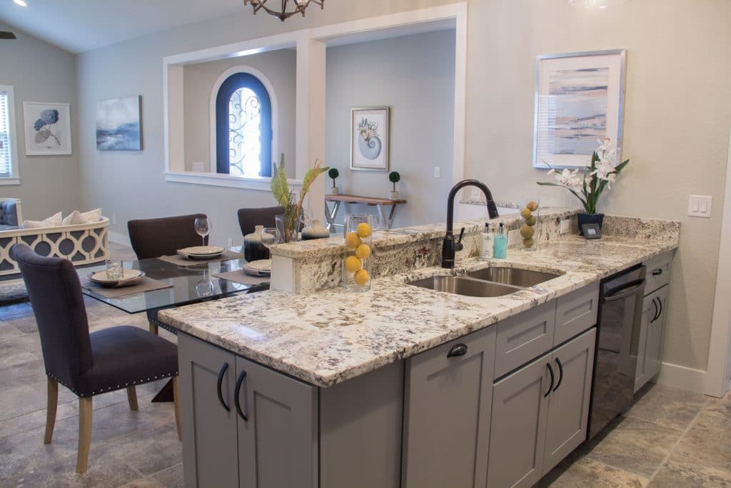 Granite kitchen counter staged with small accessories