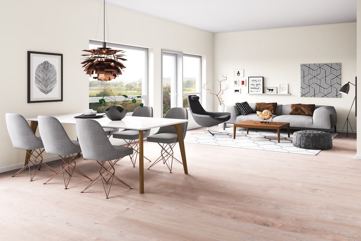 Open floor plan of dining and living room with beige walls.