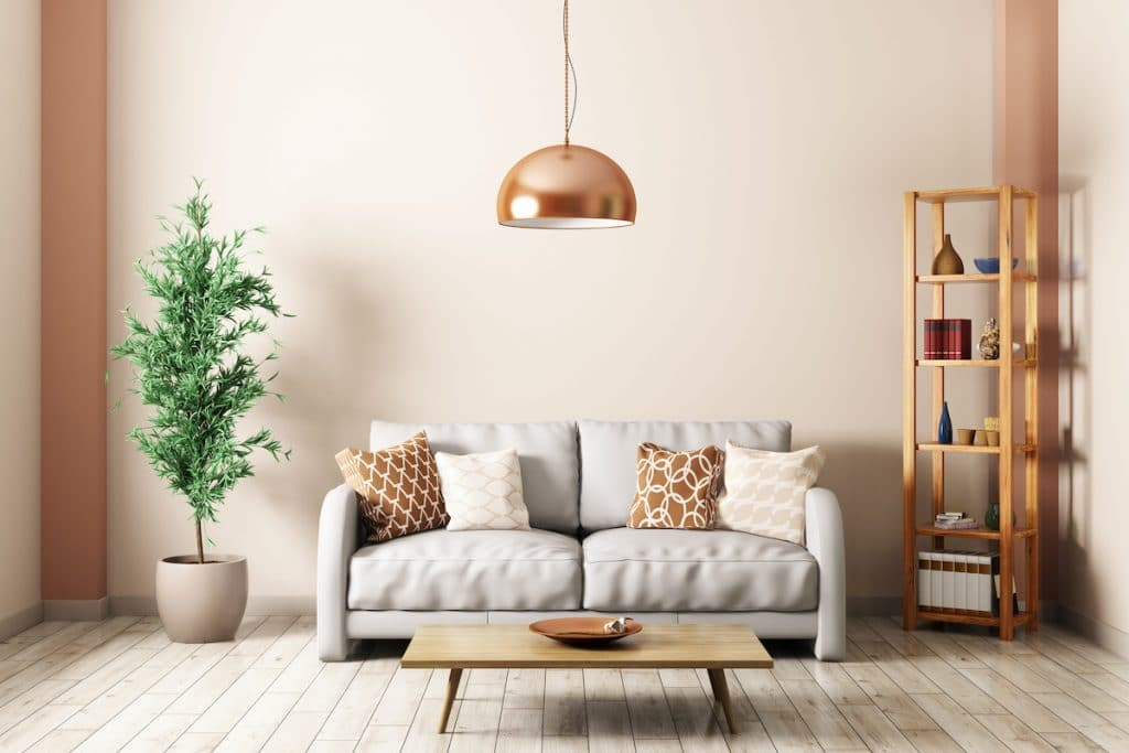 Loveseat sofa and brass pendant light with wooden shelf and tall plant nearby.