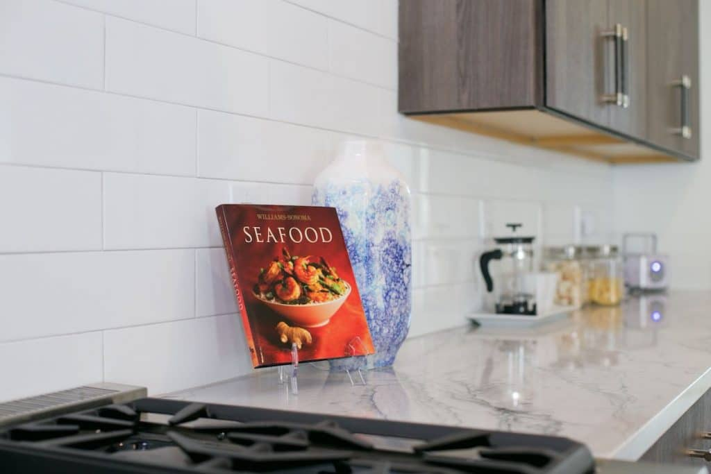 Kitchen countertop with a seafood cookbook on display.