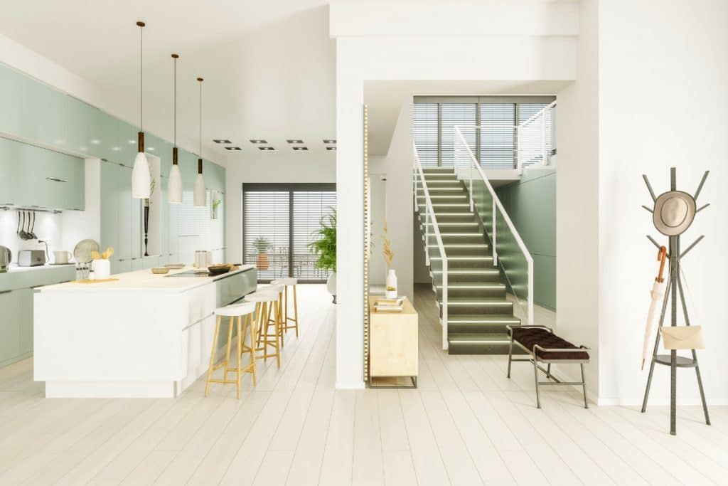 Light green cabinets in a modern white kitchen