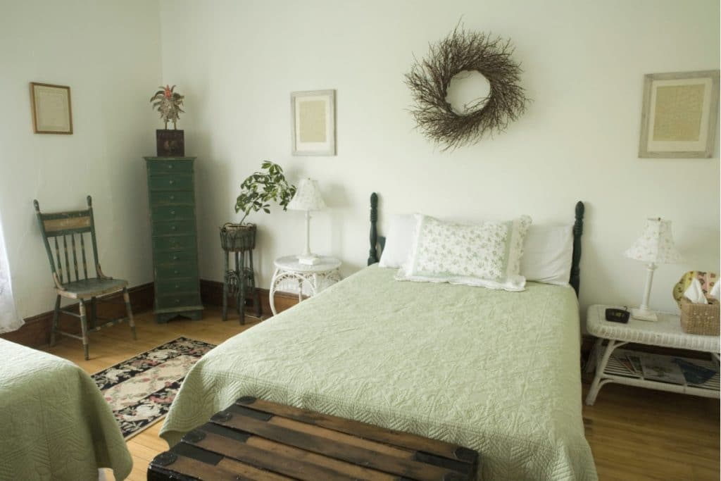 "Light green, ""shabby chic"" style bedroom"