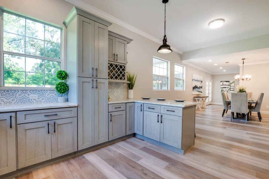Another view of kitchen with greenery on the countertops.
