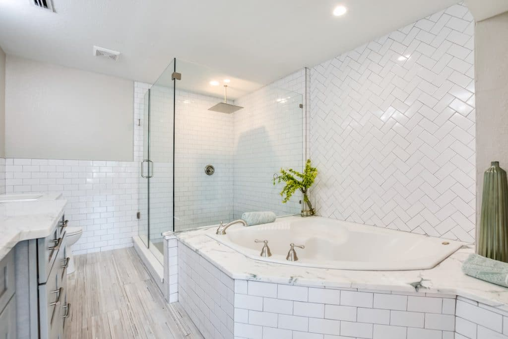 Master bathroom with view of glass shower and large tub.