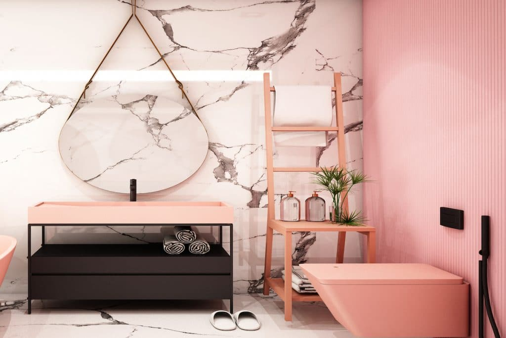 Bathroom with light coral accent wall with marble floors and wall.