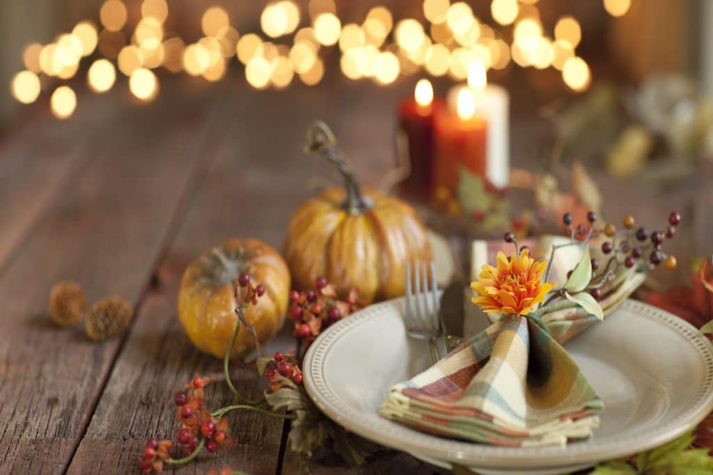 Close up of an autumn themed place setting.