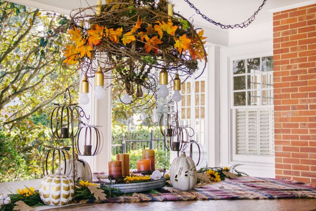 An outdoor table scape with autumn-themed decor.