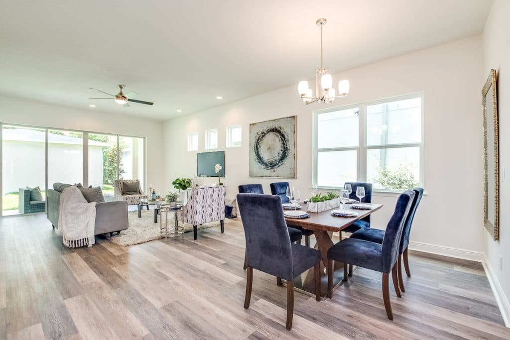 A staged open floor plan with view of dining area and living room.