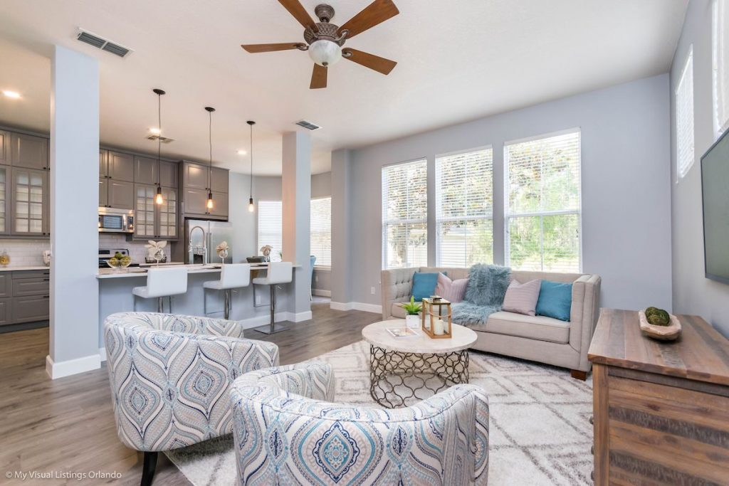 Living room with view of kitchen staged by MHM Professional Staging.