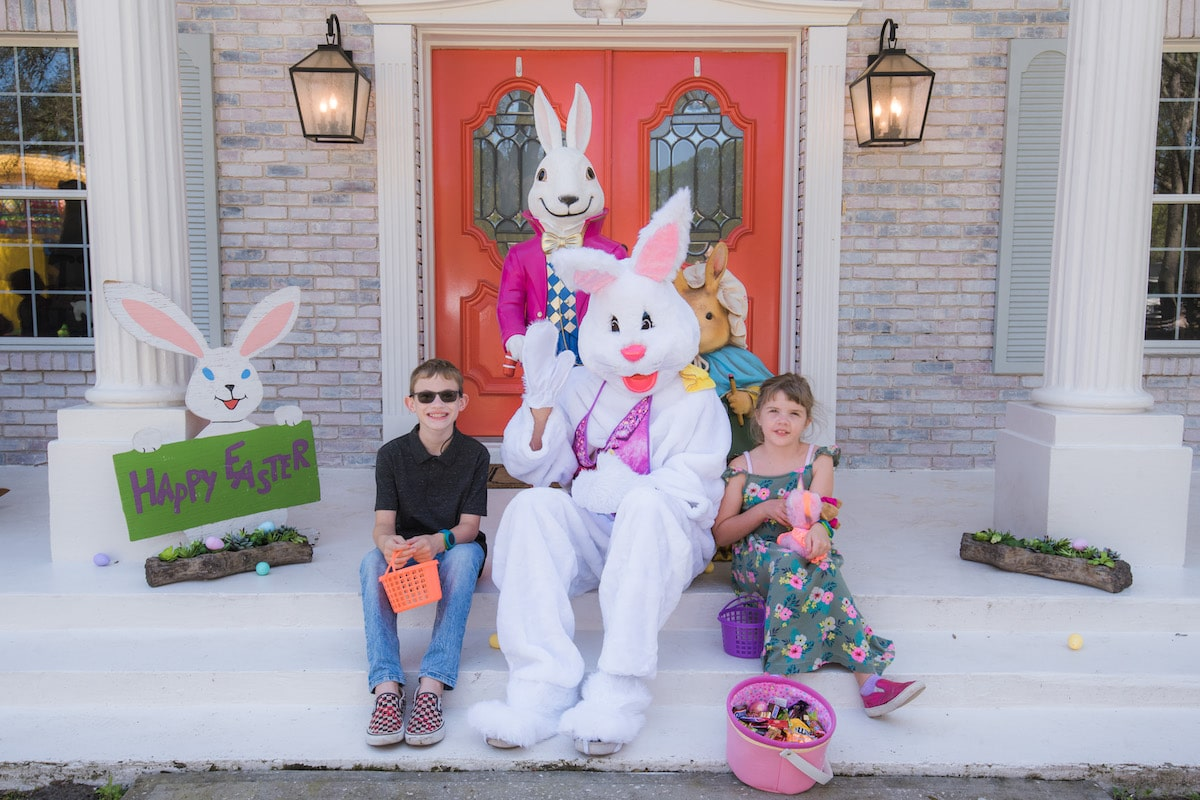 Two children posing with the Easter Bunny