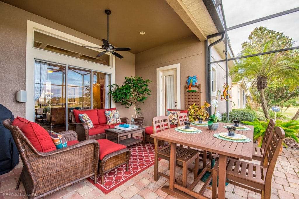 A back patio area with patio furniture and outdoor dining table.