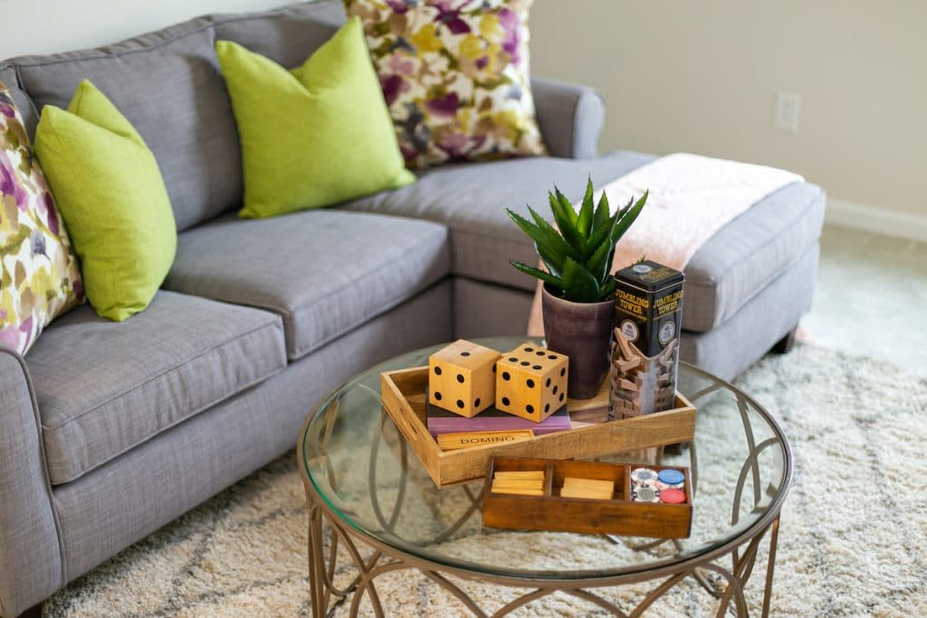 A close up of a coffee table with fun games on it.