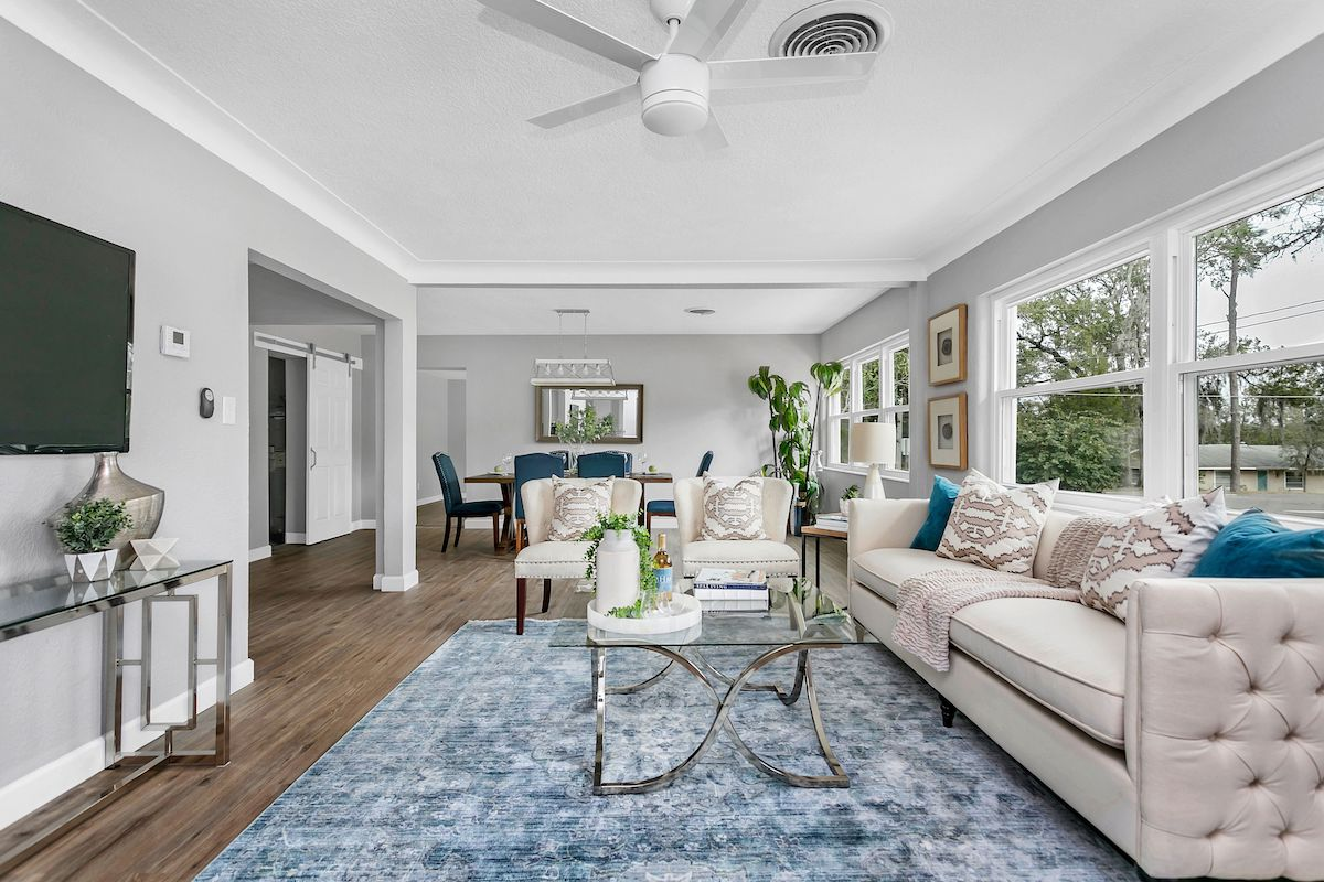 Open floor plan with view of living room and grayish blue walls.