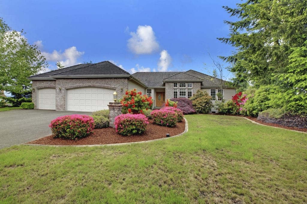 An exterior of a home with colorful landscaping.