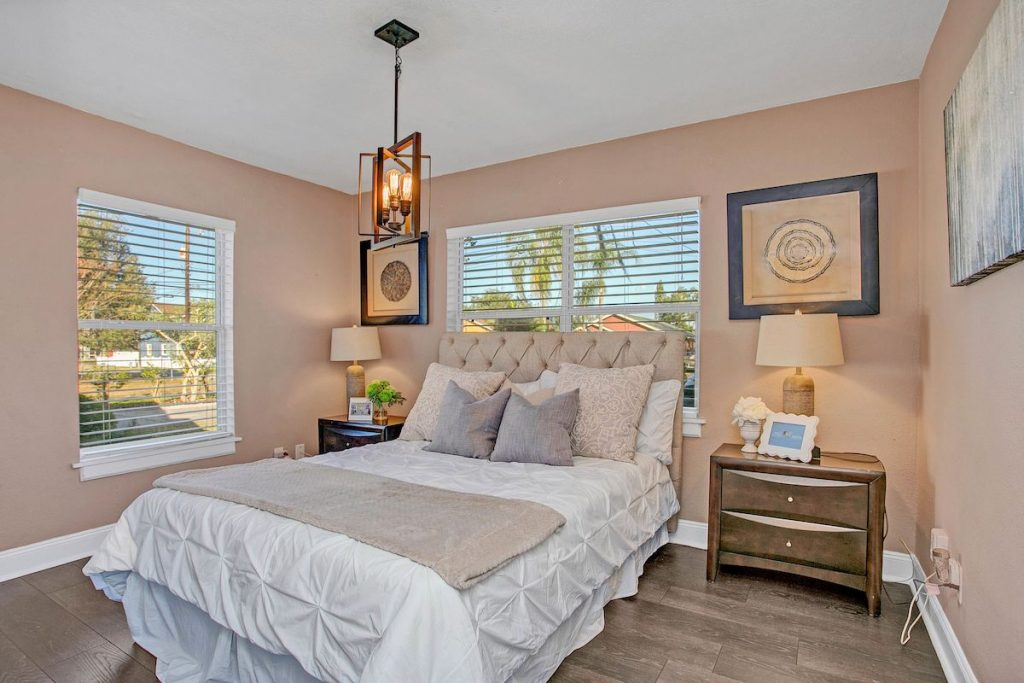 A bedroom with soft apricot walls.