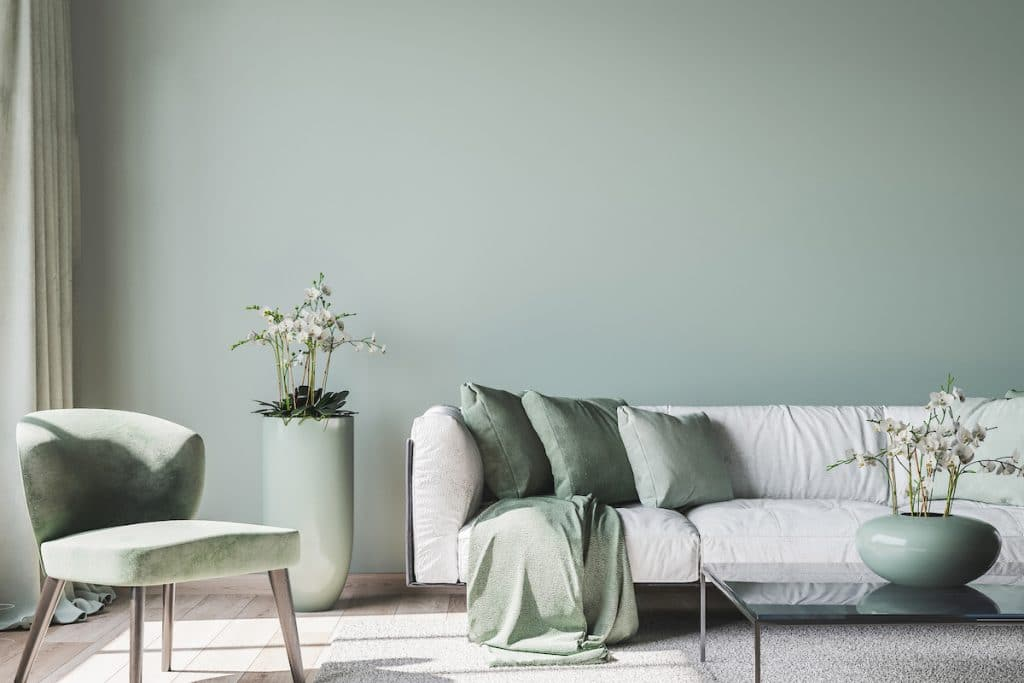 A living room with light green walls and accents.