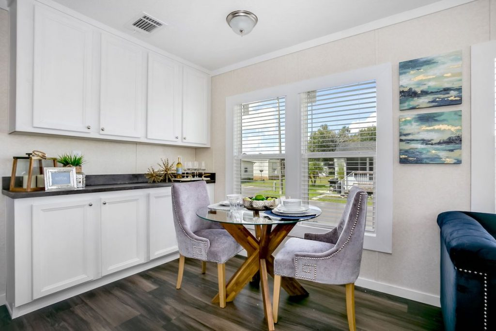 A small dining area with creamy white walls.