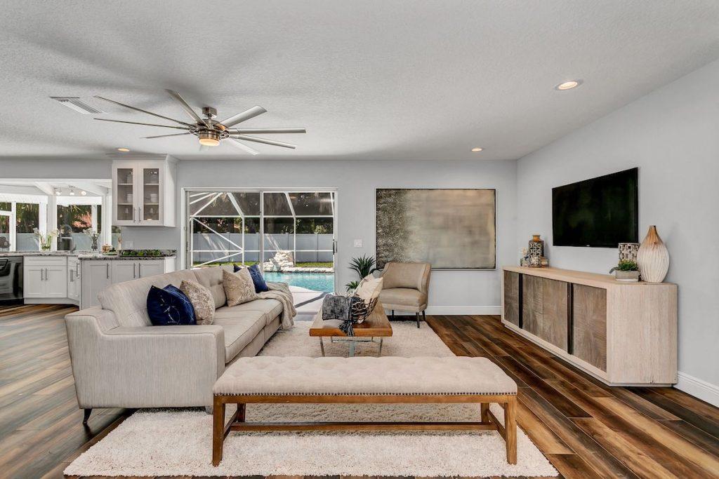 Open floor plan living room with area rug.