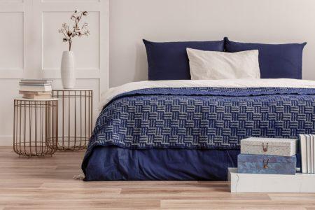 Bedroom with comforter in Naval