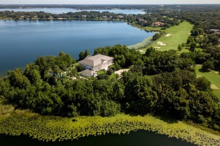 Aerial shot of Lewis' mansion and Lake Bessie